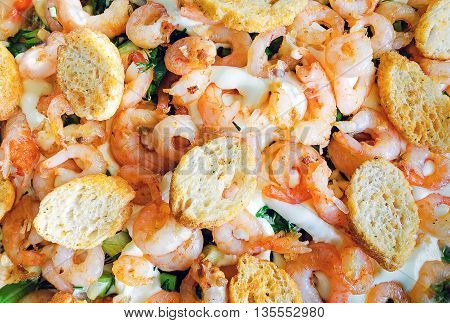 background of salad with shrimp and croutons