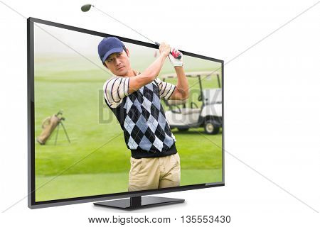 Man playing golf against view of a golf course