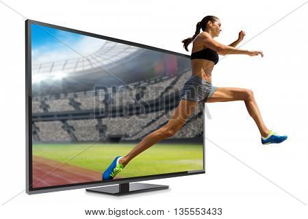 Profile view of sportswoman jumping against view of a stadium