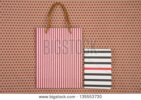 Handmade Striped Shopping Bag, Gift Bags And Notepad On Craft  Paper Background In Red Polka Dots