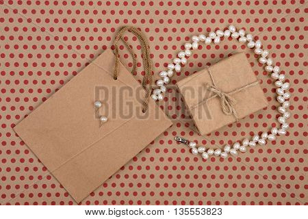 Celebratory Concept - Handmade Shopping Bag Of Craft Paper, Gift Bags, Gift Box And Women's Pearl Je