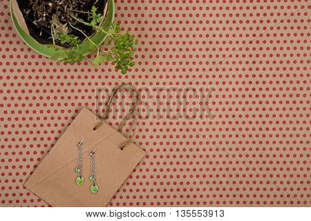 Handmade Shopping Bag Of Craft Paper, Gift Bags, Flower And Women's Fashion Jewelry On Craft  Paper