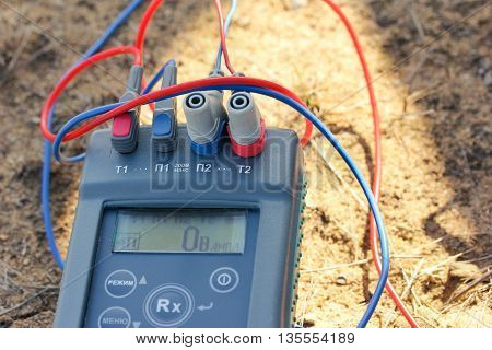 measurement of the earth. closeup of a three-phase electric cable