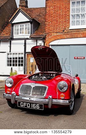 AMERSHAM, UK - SEPTEMBER 7: A classic vintage MG sports car stands on public display along the towns High Street at the annual Amersham Heritage Day show on September 7, 2014 in Amersham