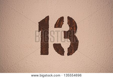 The number thirteen painted on the wall