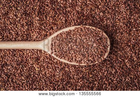 Healthy food diet. Closeup brown flax seeds linseed on wooden spoon