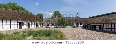 Lyngby, Denmark - June 23, 2016: Panoramic view of courtyard of an ancient danish farmhouse.