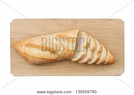 White ciabatta bread being cut in slices on wooden board isolated on white background
