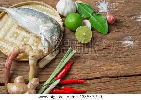 Ingredient of Tom Yum spicy soup With steamed mackerel Fish Traditional Thai food cuisine on wooden texture