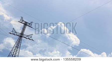 Unusual Tilted Composition Of Power Lines And Cloudscape On Blue Sky