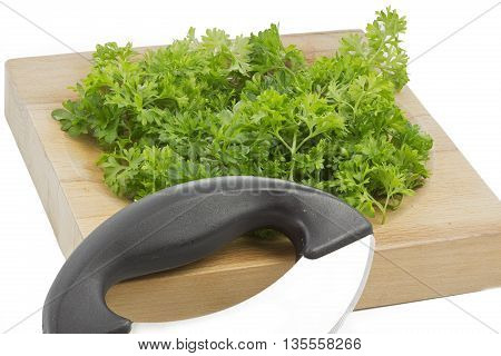Fresh parsley on a wooden chopping board, isolated
