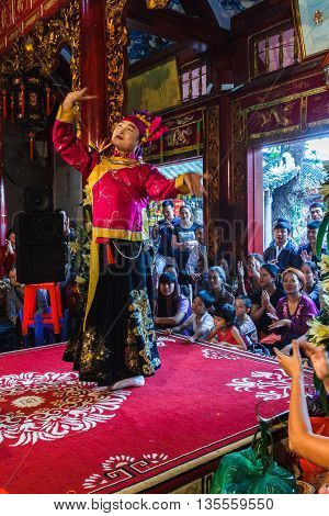Thanh Hoa, Vietnam - October 19, 2014: A female medium performs Len Dong, a spirit mediumship ritual in Central Vietnam. In trance the medium channels gods and goddesses of the Dao Mau religion.