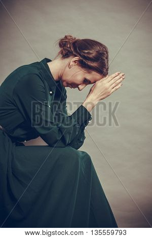 Sad woman retro style portrait long dark gown vintage photo