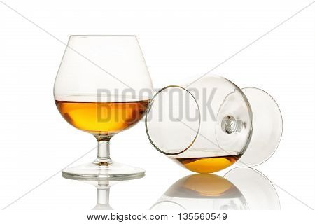 two glasses with cognac isolated on white
