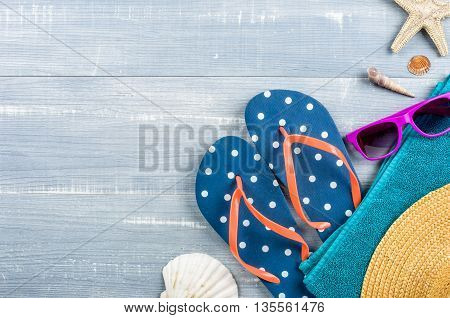Beach Accessories On A Blue Wooden Background