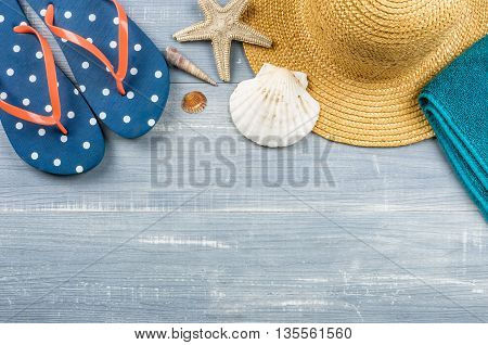 Some Beach Accessories On A Wooden Background