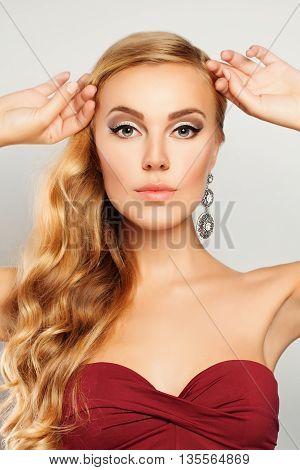 Beautiful Fashion Model. Woman with Makeup and Blond Wavy Hairstyle