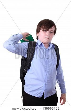 Schoolboy putting a book in a backpack isolated on a white background