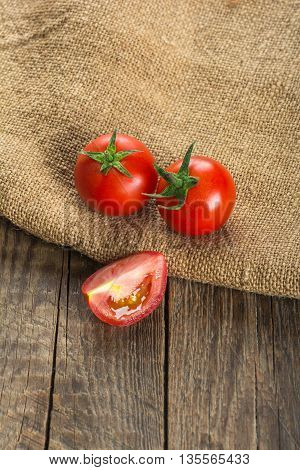 Red tomatoes on wooden surface. Selective focus