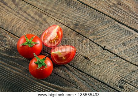 Ripe Tomatoes on wooden surface. Selective focus