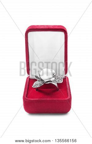 Ring with pearl and diamonds in jewel box on white background