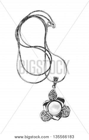 Pendant with pearl and diamonds on a chain isolated over white