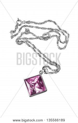 Pink quartz pendant on silver chain isolated over white