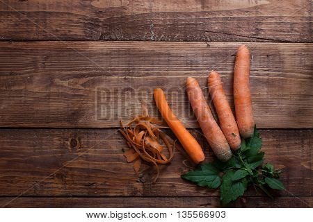 Peeling Vegetables - Carrots And Potatoes On Wooden Board - Studio Shot From Above