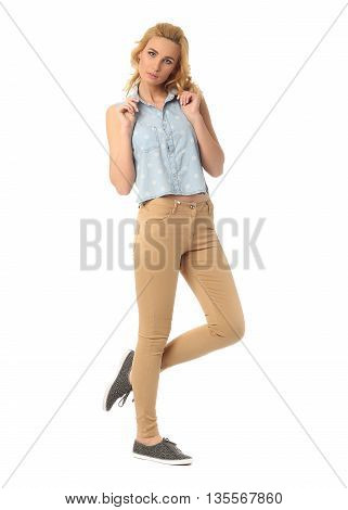 Portrait Of Beautiful Young Woman In Jeans Isolated