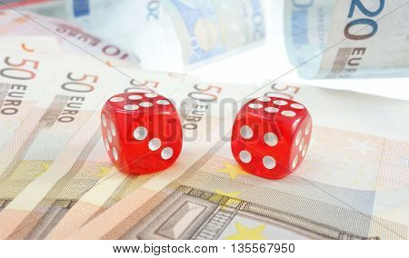 Red dice on Euro notes -- EU economy concept