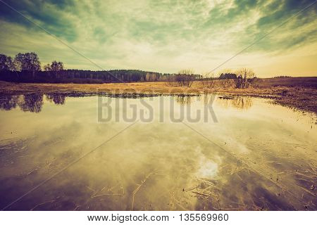 Vintage Photo Of Landscape With Puddle