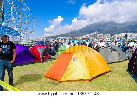 QUITO, ECUADOR - JULY 7, 2015: Various tents on the grass, people of various cities arrived several days before to attent to pope Francisco mass.
