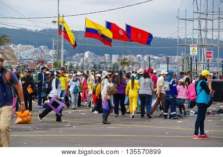 QUITO, ECUADOR - JULY 7, 2015: After the mass of pope Francisco, people walking trying to get to their homes.