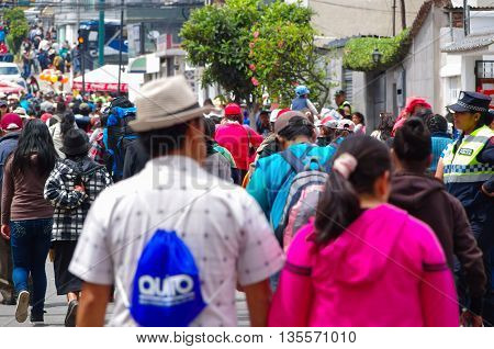 QUITO, ECUADOR - JULY 7, 2015: People trying to arrive to pope Francisco mass, police making guards on streets.
