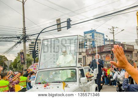 QUITO, ECUADOR - JULY 7, 2015: Emotional photo near pope Francisco in his popemobile, Ecuador welcome.