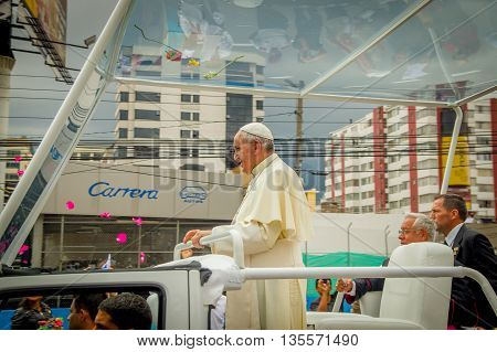 QUITO, ECUADOR - JULY 7, 2015: Pope Francisco stand up in his popemobile, behind his bodyguard and Ecuador monsignor.