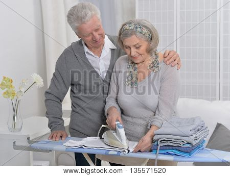 happy Senior couple during ironing at home