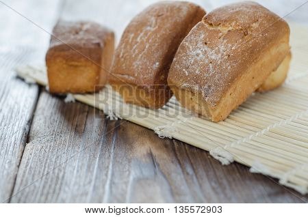 Homemade sweet cake on the table wooden background