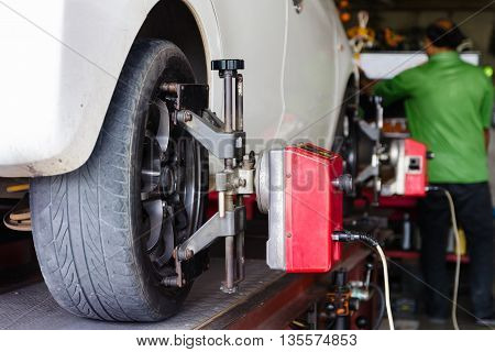 Close up shot of car wheel centering machine adjustment shallow depth of field