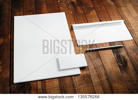 Photo of blank stationery set. Blank template for branding identity. Blank letterhead business cards envelope and pen. Mock-up for branding identity for designers.