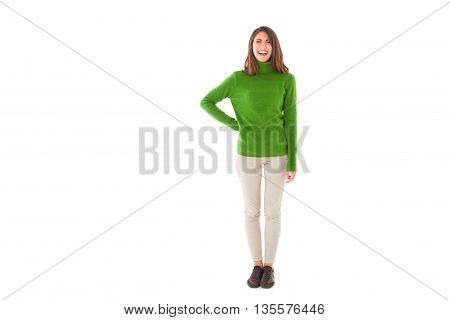 Full length of young woman smiling. Beautiful female is wearing green turtleneck sweater. She is standing isolated on white background.