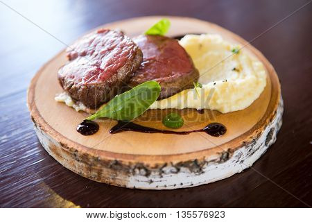 Prepared mignon steak served with mashed potato