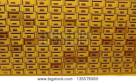 Postal boxes in condominium for informations in yellow light
