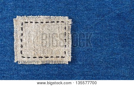 canvas label patch on blue jeans background