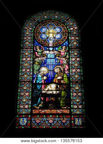 Montserrat, Catalonia, Spain - September 09, 2014: Nativity scene.  Old beautiful  stained glass window in the  Basilica of  the famous Benedictine Monastery   Montserrat, located in the mountains 56 km from the city Barcelona.