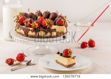 Delicious cheesecake with berries on table close up. White wooden background. Tasty dietary pastries. Natural product. Light dessert.