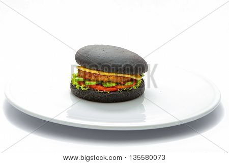 Burger black dough with chicken burgers cheese cucumbers tomatoes and lettuce cast