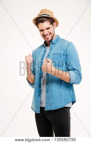 Casual handsome man rejoices isolated on the white background