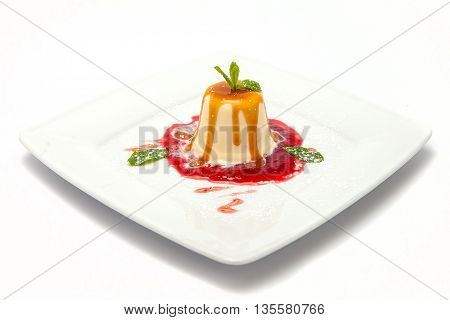 panna cotta with raspberry jam and caramel topping