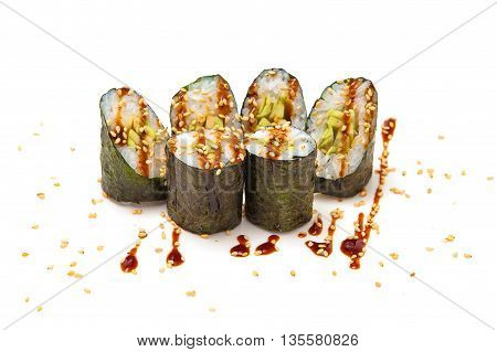 sushi roll with avocado and sesame unagi sauce